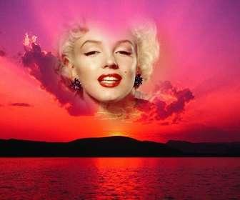 Fotomontaggio di un tramonto con un cielo rosa e una cornice a forma di cuore dove si può mettere una foto.