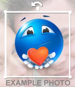 Emoticono azul con corazón rojo