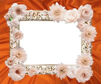 Marco para fotos con flores blancas y una tela detrás